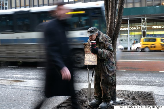 A homeless man begs for donations outside a subway station in New York on February 4, 2015. New York may be famous abroad for glitz, glamor and Park Avenue billionaires but America's biggest city has passed a grim milestone -- a record 60,000 people are homeless. In November, there were 60,352 homeless people in the city, including 25,000 children, up more than 10 percent on the 53,615 who were homeless in January 2014, according to the website for charity Coalition for the Homeless. AFP PHOTO/JEWEL SAMAD (Photo credit should read JEWEL SAMAD/AFP/Getty Images)
